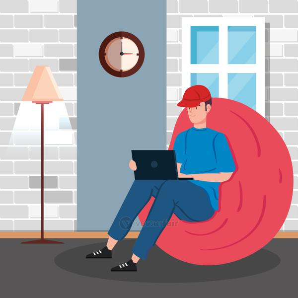 man working in telecommuting sitting in pouf soft inside house
