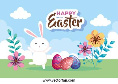 happy easter card with eggs decorated and rabbit