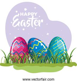 happy easter card with eggs decorated in grass