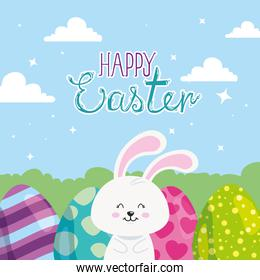 happy easter card with rabbit and eggs in landscape
