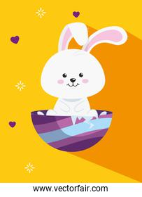 cute rabbit in egg easter decorated