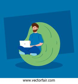 man working in telecommuting with laptop sitting in pouf soft
