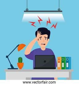 man with stress attack in workplace