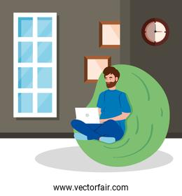young man working in telecommuting sitting in pouf soft inside house