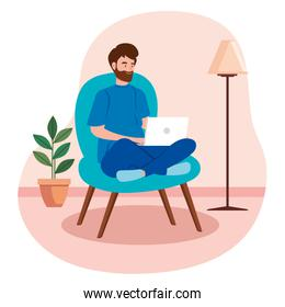 male working in telecommuting with laptop inside house