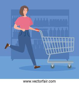 woman with cart shopping running