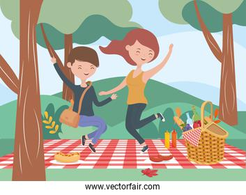jumping couple blanket food picnic nature outdoors