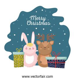 merry christmas celebration cute rabbit and reindeer with gift boxes snow