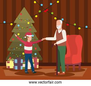 grandfather and grandson celebrating christmas in livingroom with tree