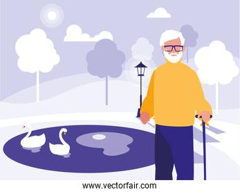 old man walking in park in the city