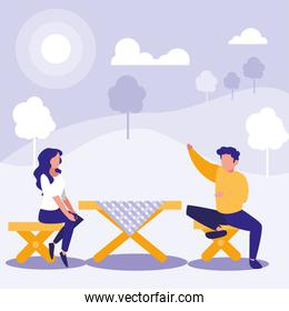 couple of people sitting in dining