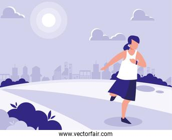 woman in park in the city doing sports
