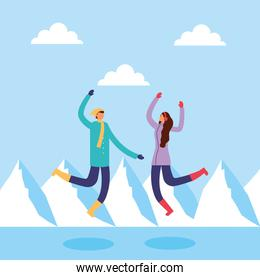 couple in snowscape practicing activities