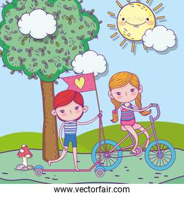 happy childrens day, boy riding scooter and girl with bike outdoor
