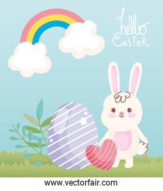 happy easter white rabbit with heart and egg decoration in grass rainbow
