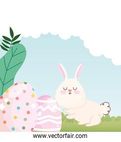happy easter white bunny with dotted and lined eggs decoration in grass
