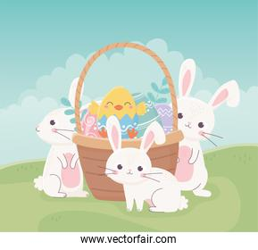 happy easter rabbits chicken in basket with eggs in grass