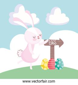 happy easter cute rabbit with eggs and arrow on grass