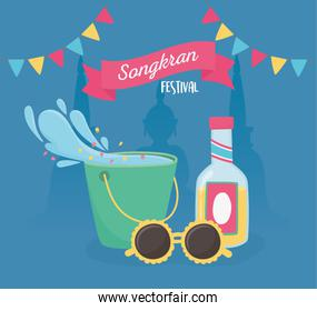 songkran festival bucket water splash sunglasses drink bottle flags