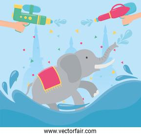 songkran festival hands with water guns and elephant
