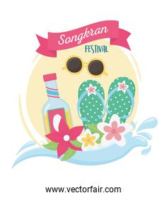 songkran festival flip flops drink bottle and flowers card