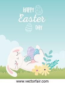 happy easter day, rabbit resting with eggs flowers in grass