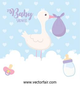 baby shower, stork with purple diaper and bottle pacifier on clouds decoration
