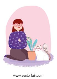 young woman with white cat and potted plant