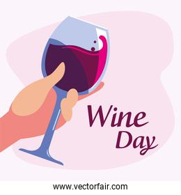 Hand holding cup of wine day vector design