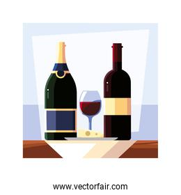 bottle and glass of wine with piece of cheese