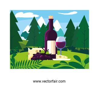 bottle and glass of wine with piece of cheese and grapes