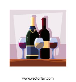 bottle and glass of wine on table
