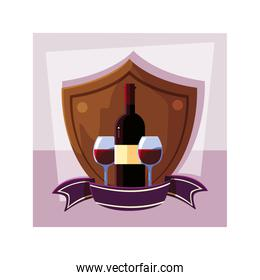 bottle and glass of wine in shield with ribbon