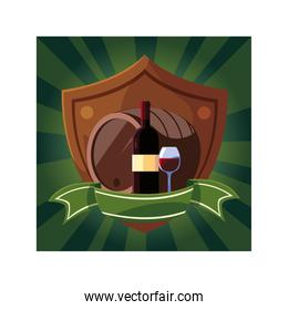 bottle and glass of wine with barrel in shield with ribbon