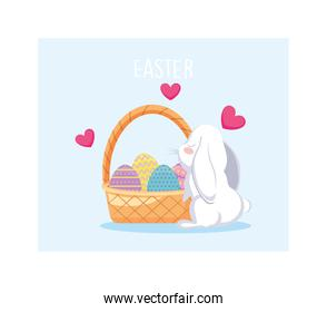 wicker basket with colorful easter eggs and rabbit