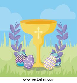 happy easter design of communion wine glass, decorative wreath and easter eggs, colorful design