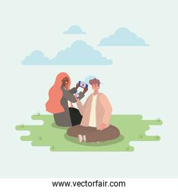 Girl and boy with smartphones at park vector design