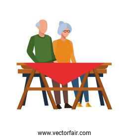 old couple and picnic table icon, flat design