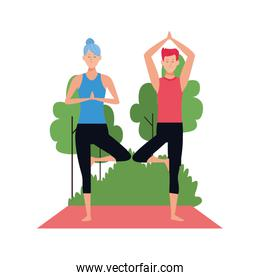man and woman practicing yoga at outdoors