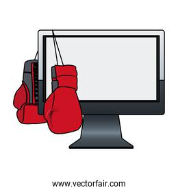 boxing gloves hanging on computer monitor