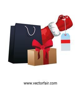 shopping bag and gift box with santa claus arm holding a price tag