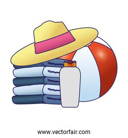 stack of towels with beach hat and ball