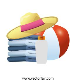 stack of towels with beach hat and ball, colorful design