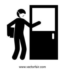 silhouette of delivery worker using face mask giving package