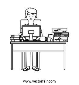 man working with desktop in desk and pile documents