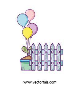 fence potted plant and balloons decoration