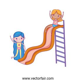 isolated cute girls playing in slide playground park