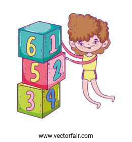 happy childrens day, boy playing with numbers blocks park