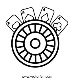 roulette wheel and poker cards casino