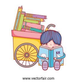 boy sitting reading book pirates and handcart with books